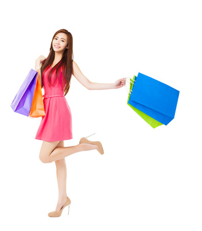 asian girl shopping: young woman with shopping bags isolated on white
