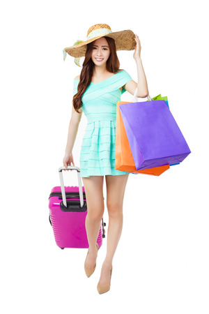 asian girl shopping: young woman holding shopping bags and travel suitcase