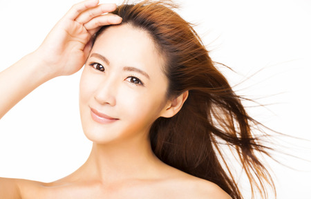 beautiful young woman with the flying hair photo