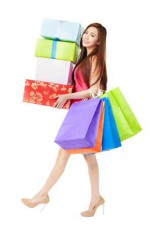 young woman with shopping bags and gift box photo