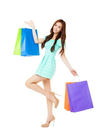 asian girl shopping: happy young woman holding the shopping bags Stock Photo