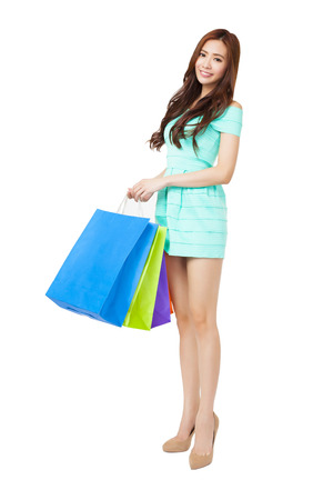happy young woman holding the shopping bags photo