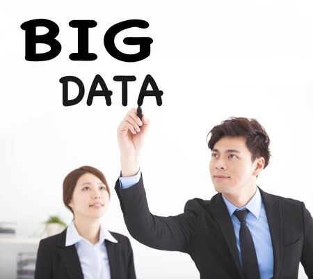 business people drawing big data text in office photo