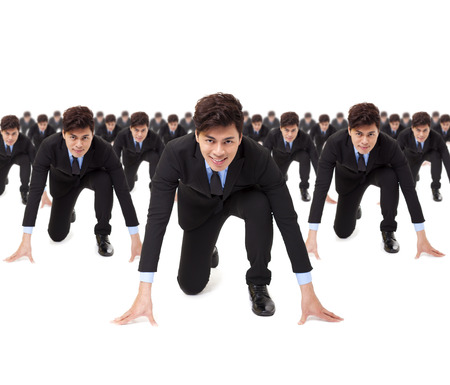 competitor: young businessman ready to run with competitor Stock Photo