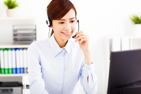 secretary office: young beautiful asian businesswoman with headset in office Stock Photo
