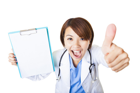 young woman doctor showing  blank clipboard with thumb up photo