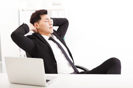 chinese businessman: relaxed Young businessman  in the  office Stock Photo