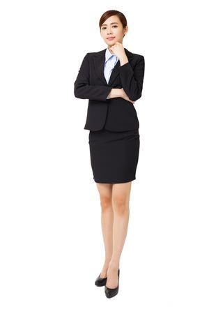 full length: volledige lengte jonge zakenvrouw met het denken gebaar Stockfoto
