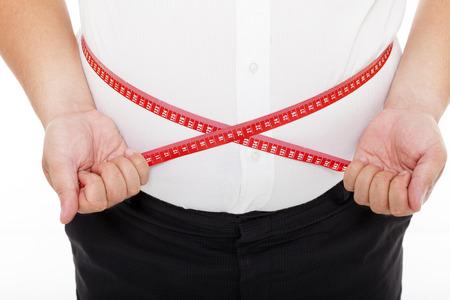 gordos: Hombre gordo que sostiene una cinta de medici�n Foto de archivo