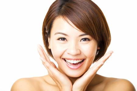 caras de emociones: rostro de mujer joven feliz y hermosa Foto de archivo