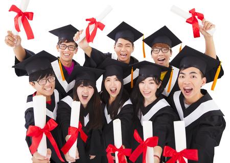 academic achievement: Group Of asian Students Celebrating Graduation