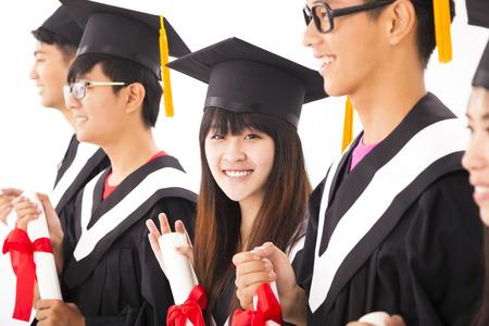 academic robe: beautiful asian female college graduate at graduation with classmates