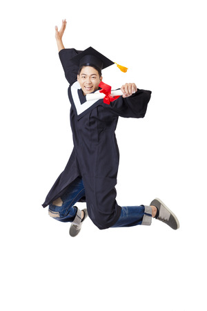 a white robe: Happy  student in graduate robe jumping against white background