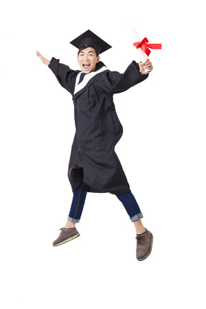 academic robe: Happy  student in graduate robe jumping isolated on white Stock Photo