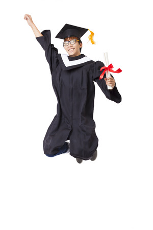 Robe: Happy  student in graduate robe jumping against white background