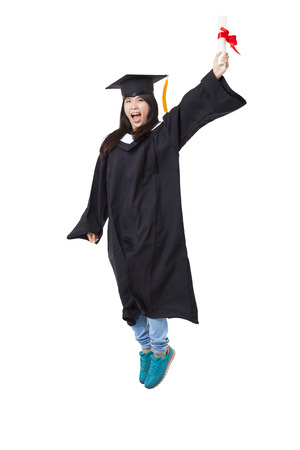 Robe: Happy  student in graduate robe jumping isolated on white Stock Photo