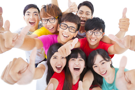 asian success: happy Young people group with thumbs up