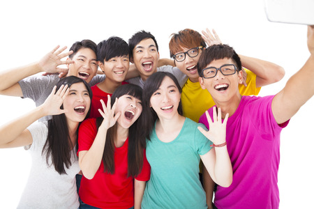 group of smiling friends with camera  taking self photo Stock Photo