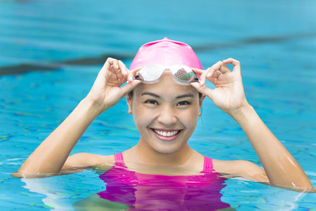 young woman close up portrait in swimming pool Stock Photo