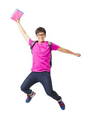happy young man student jumping
