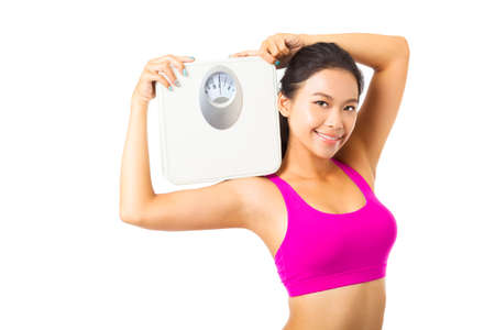 woman on scale: Young woman  holding the weight scale