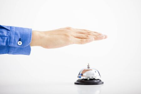 Businessman hand ringing the bell for assistance photo