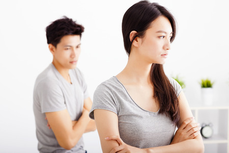 argument from love: young Couple not talking after  fight  in living room