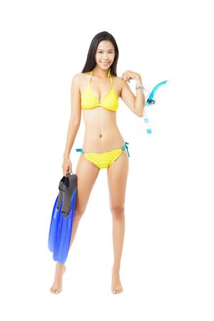 asian sport: young woman in bikini holding equipment for snorkeling