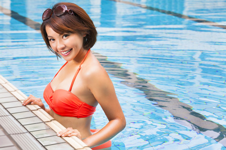 beautiful young woman  in  swimming pool photo