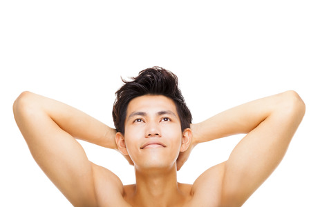 Handsome smiling young man looking up Stock Photo
