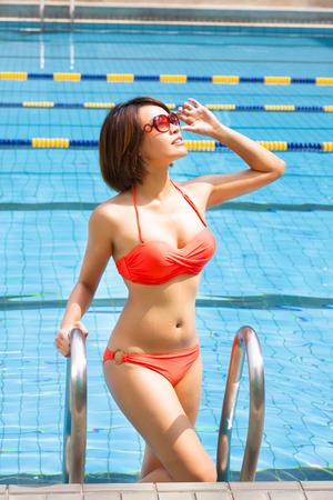 beautiful young woman  in  swimming pool photo
