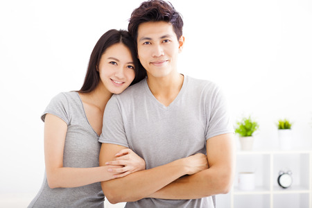 Young happy couple hugging and smiling Stock Photo