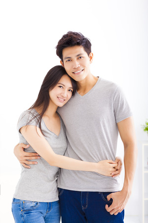 asian girl face: Young happy couple hugging and smiling Stock Photo