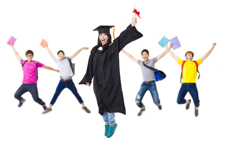academic robe: Happy  student group in graduate robe jumping together Stock Photo