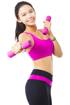 strong woman: happy young woman exercising with dumbbells