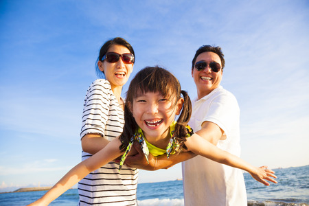family holidays: happy family enjoy summer vacation on the beach