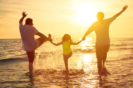 summer fun: happy family enjoy summer vacation on the beach