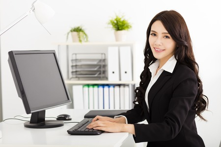 working woman: young business woman working in the office