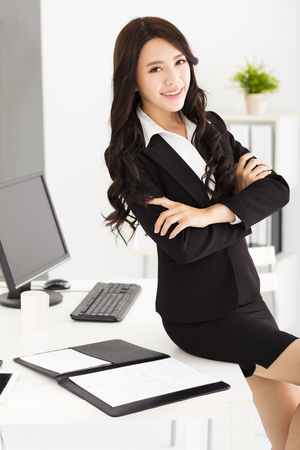 beautiful young businesswoman standing in the office photo