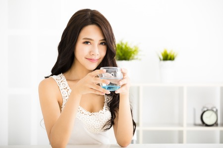 fresh water: relaxed young smiling woman drinking clean water