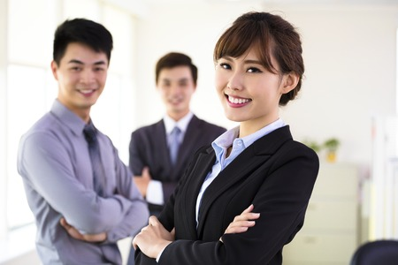 asian businesswoman: successful young business team standing in office Stock Photo