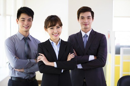 business woman working: successful young business team standing in office Stock Photo