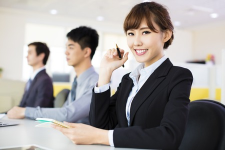 asian office lady: business woman with her staff in conference room