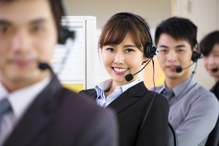assist: young business people working with headset in office
