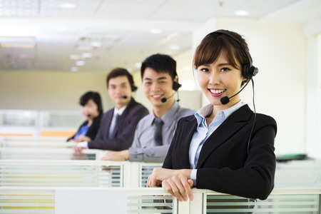 to phone calls: young business team working with headset in office