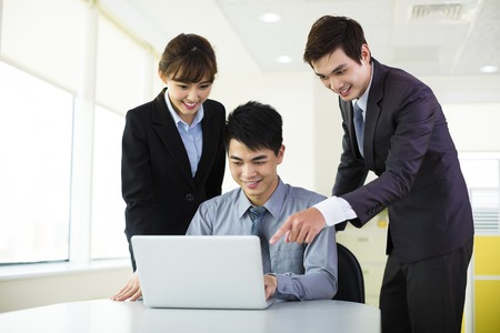 asia people: Young business colleagues working in the office