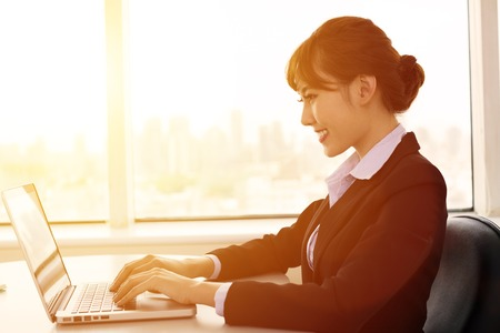 people relaxing: young   businesswoman working in the office at morning
