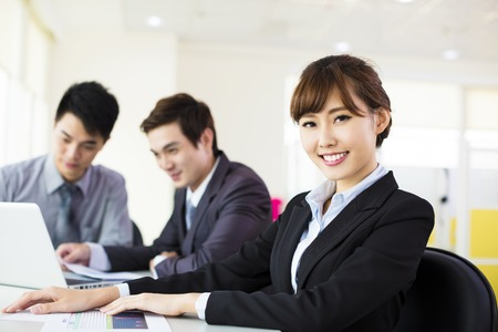 happy asian people: Young business woman working in the office