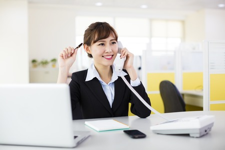 businesswoman talking on the phone in the office