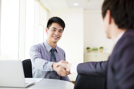 business man hand shaking in office Standard-Bild